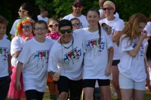 Mr. Olmsted with students at color run